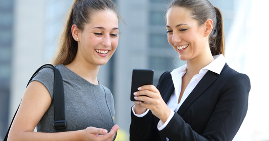 Friendly IT professional demostrating mobile technology to a client
